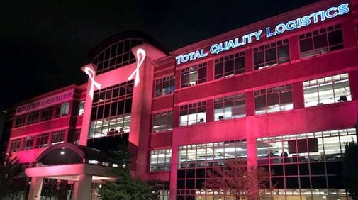 TQL building with projected breast cancer ribbons