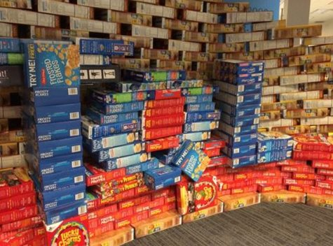 Boxes Of Cereal Stacked Up A Wall