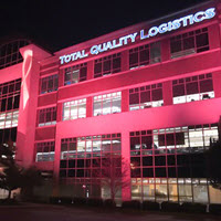 TQL headquarters illuminated in pink for Breast Cancer Awareness Month.
