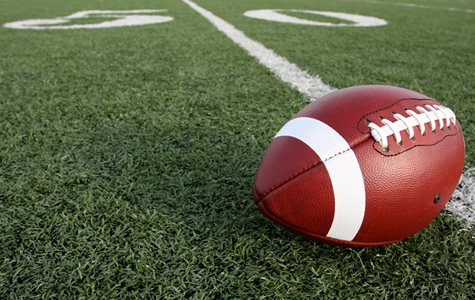 A Football Placed On The 50 Yard Line Of A Football Field