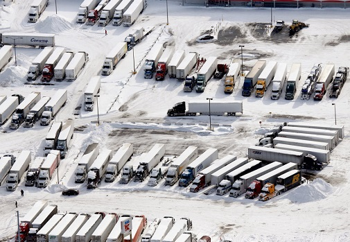 Parked Semi trucks in a snow covered lot