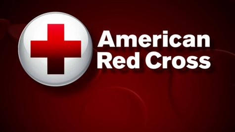 American Red Cross Logo In Front Of A Dark Red Background