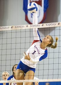 Female Volleyball player spiking ball
