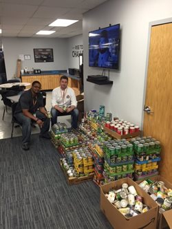 Two men with canned goods