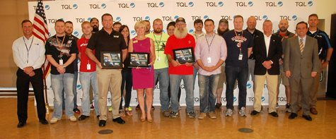 Group Of TQL Employees Smiling With The Mayor Of Cincinnati And Three Plaques