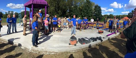 A Group Of People Getting Ready To Build A Playground For Community Service