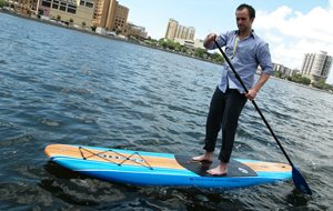 Man paddle boarding on body of water
